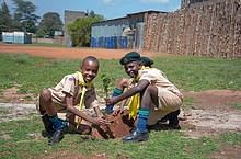 Scouts planting trees at Huruma Primary